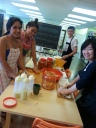 CLC's volunteer club preparing the Kimchi for our famous Kimchi hot dog